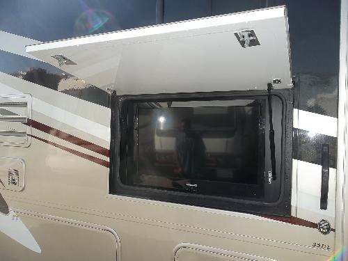 television screen attached to exterior side paneling of the Mirada 36 foot